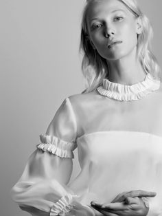 """The Azeline is a signature model from maison Anne Fontaine.Combining transparency at the shoulders, puffed sleeves enhanced by little """"vertiges"""" ruffles and cuffs in the shape of a flower corolla, Azeline embodies femininity and freshness."""