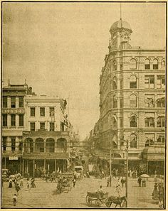 """""""Chartres Street"""" New Orleans, c 1900. View looking down from intersection with Canal Street. Pedestrians and horse drawn traffic; old Godchaux's Building at right. Date 1902 (publication date) Source Photo on page 91 of book """"New Orleans Guide, with descriptions of the routes to New Orleans, sights of the city arranged alphabetically ... also, outlines of the history of Louisiana"""" by Hon. James S. Zacharie. Pub. F. F. Hansell, New Orleans, 1902"""