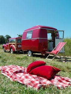 Cute red camper pulled by a vintage woody!  How cute is that????