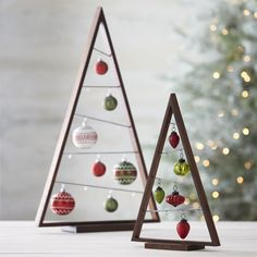 "Crate and Barrel's ""A Frame Ornament Trees"" make for a fantastic modern Christmas tree. I think the larger size would be big enough to act as a stand-alone tree."