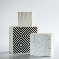 Store in style with this set of three printed geometric boxes.  A House Doctor DK product