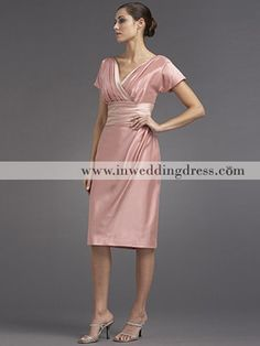 This dress in a light pink hue draws attention to the upper body with the v-neckline and a defined waist.  This is a simple and elegant dress.