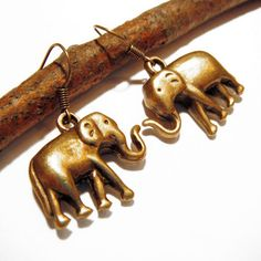 "Elephant Earrings Brass  by Britt Baker (""In many cultures, pachyderms are considered good luck. Wear the Elephant Earrings when you're awaiting something especially fortuitous or just need a little confidence boost."")"