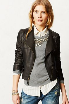 Black moto jacket with grey sweater or sweatshirt and a statement necklace