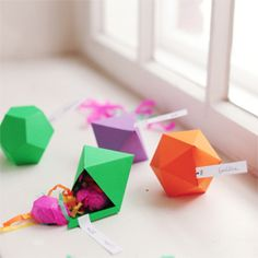 Geometric faceted favour boxes, including a printable pattern.