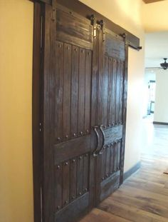 rustic barn doors & the detailed decorative accents.foyer and great room doors to diningthese rustic barn doors & the detailed decorative accents.foyer and great room doors to dining Custom Wood Doors, Barnwood Doors, Wooden Doors, Rustic Hardware, Building A Barn Door, Sliding Barn Door Hardware, Sliding Doors, Traditional Doors, Pole Barn Homes