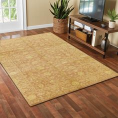 A rustic rosy brown background sets the stage for the intricate, daffodil-colored design featured in this one-of-a-kind rug. This sophisticated style piece would look great against dark wood floors or antique furniture. #goldrugs #buygoldrugs #buygoldrugsonline #rugknots Gold Rugs, Beige Rugs, Dark Wood Floors, Cheap Rugs, Oriental Design, Daffodil, Sophisticated Style, Furniture Collection, Or Antique