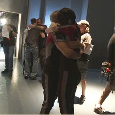 Josh and Jen hugging on set.