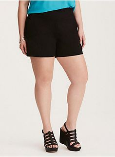 """Shorts at cocktail hour? Yup, we're that good. Form-fitting, yet totally stretchy, black ponte already turns up the sophistication, while a mid-rise length can easily be worn with tights or bare. The zip side keeps the smooth front fitted. Faux back pockets lend a trouser aesthetic.<div><ul><li style=""""list-style-position: inside !important; list-style-type: disc !important"""">Mid-rise</li><li style=""""list-style-position: inside !important; list-style-type: disc !important"""">5"""" inseam</li><li…"""