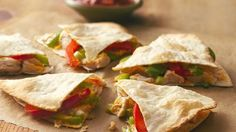 Make an entree for two in 20 minutes! Fast-to-fix quesadillas are bursting with chicken, peppers and cheese.