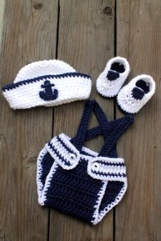 Cute little Sailor/nautical set...comes with a sailor hat, diaper cover and suspenders, and little shoes...diaper cover has a white anchor on the back.