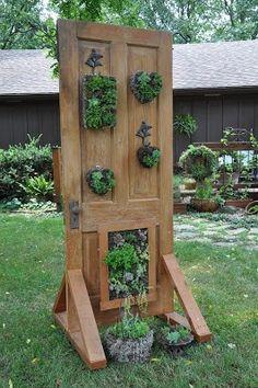 Door with base for hanging living wreaths via Rebecca's Bird Gardens