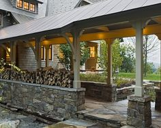 Stone and Wood Breezeway with Logs. Covered entry between the garage and the main entrance