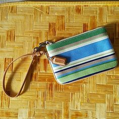 67ab539776fdf9 Coach Stripe Wristlet blue/green/tan Never used NWOT or dust bag. This