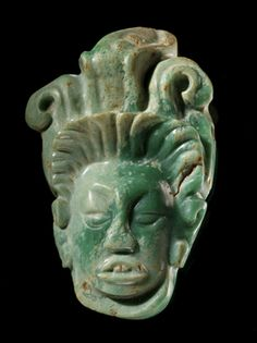 probably Classic period Maya (archaeological culture) (attributed)  Pendant representing the Maize God  Date created: AD 300-900  Place: Palenque; Palenque Municipality, Selva Region; Chiapas State; Mexico  Media/Materials: Jade  Techniques: Carved, polished, drilled