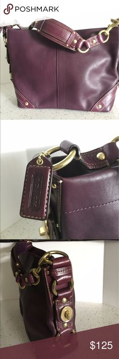 Authentic Coach leather bag Dark purple leather hobo style bag. Only used a few times. Still has some plastic cover on gold hardware. Soft leather. Comes with original dust bag. Has a zipper pocket and 2 open pockets inside. Interior is golden fabric lined. Very roomy bag. Comes from a smoke & pet free home. Doing closet clear out. Make an offer! Coach Bags Hobos