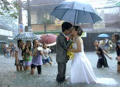 These Filipino newlyweds showed love conquers all when they pushed through with their scheduled wedding despite severe flooding that inundated wide areas of Manila and nine nearby provinces.
