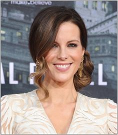 Side-Swept Chignon Kate Beckinsale wavy side bun is oh-so-glamorous—and only requires a curling iron to get the look