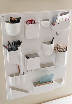 I think I could manage a DIY version of this by cutting bowls & cups in half and mounting to a board along with a few other items. Kid Spaces, Wall Spaces, Wall Mounted Hooks, Cubicle Makeover, Office Cubicle, Playroom Organization, Diy Storage, Office Decor, House Rooms