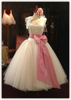 crinolin vintage inspired tea length wedding gown with big pink bow