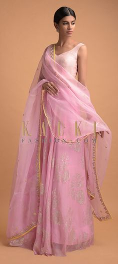 Buy Online from the link below. We ship worldwide (Free Shipping over US$100)  Click Anywhere to Tag Pastel Pink Skirt And Crop Top With Weaved Floral Pattern And Badla Work Online - Kalki Fashion Pastel pink skirt in chiffon with weaved floral pattern and badla work on the waist.Paired with a matching unstitched blouse in raw silk with zari, thread and gotta patch embroidered floral pattern.
