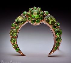 """Russian Demantoid Garnet Brooch Pin circa 1885 of a crescent shape, centered with a cluster  flanked by two large oval demantoids. All stones have """"horsetail"""" inclusions typical for Russian Uralian demantoids"""