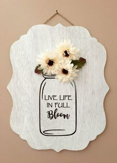 Since Spring is just around the corner we wanted to combine some of our favorite things- adhesive vinyl mason jars flowers and wood for our latest project. By adding adhesive vinyl to wood weve given this sign a unique look. Mason Jar Flowers, Diy Flowers, Mason Jars, Flower Vases, Canning Jars, Flower Crafts, Spring Projects, Spring Crafts, Diy Vinyl Projects
