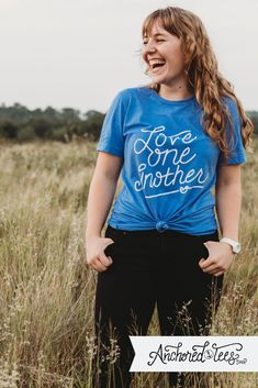 LOVE ONE ANOTHER CHRISTIAN T SHIRT Don't settle for ordinary Christian tees! Fresh designs for the confident Christian! Every t shirt gives back to high school scholarships for Tanzanian girls! Christian Clothing, Christian Shirts, Christian Women, Cool T Shirts, Tee Shirts, Cute Woman, Hand Drawn, Handmade Products, Handmade Crafts