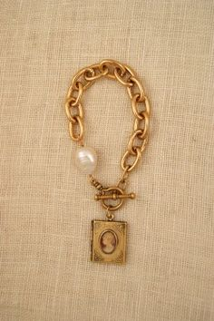 Chunky Gold Bracelet with vintage cameo locket charm by ExVoto Vintage Jewelry. #vintagejewelry #locket #cameo
