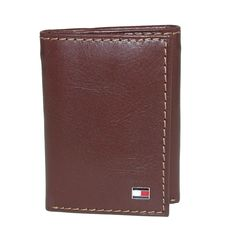 This trifold wallet is a great classic design, perfect for keeping everything together and organized. The inside bill slot pocket is great for keeping large bills secure. Tommy Hilfiger Wallet, Leather Men, Just For You, Slot, Zipper, Logan, Men's Wallets, Pocket, Products
