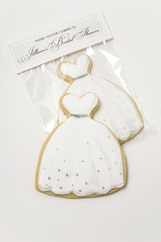 wedding dress cookies with edible glitter decorations for bridal shower party favor