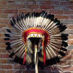"""This 'Antique' Headdress is a reproduction of a Native American artifact. It was created and made by two Navajo artists, Linda Lee and Betsy Piaso, including intricate beading and painted feathers This headdress measures 40""""H x 26""""W x 12"""" D -- stand sold separately, and is currently available in our Prescott Store for immediate delivery. Black Arrow Jewelry & Art -- Native American Artifact Reproductions"""