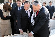 Israel Hayom | Prime Minister Netanyahu and French President Hollande visit graves of Toulouse terror victims