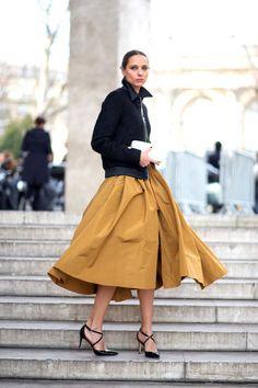 Black zip jacket + ochre taffeta wrap midi skirt + black patent cross strap pumps :: Candela Novembre :: Paris :: HarpersBAZAAR.com