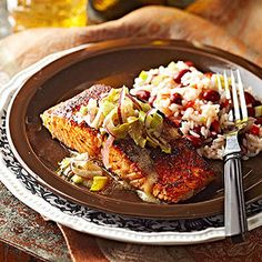 Cajun-Rubbed Salmon: Fish made easy! Start with a quick sear—one of cast iron's best tricks—to seal in moisture; finish by baking in the oven. A simple pickle relish tops the spice-rubbed fish with tang. Supper Recipes, Top Recipes, Salmon Recipes, Fish Recipes, Seafood Recipes, Cooking Recipes, Seafood Dishes, Seafood Meals, What's Cooking