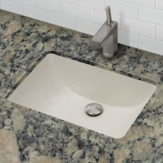 DECOLAV's Classically Redefined® Collection 1402-CBN includes skillfully crafted vitreous china pieces which are fired and glazed for durability and stain resistance. The rectangular ceramic undermount sink with overflow is stylish and functional for any bathroom.