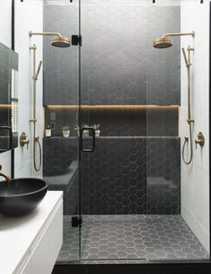 black honeycomb tiles in the shower to highlight the zone