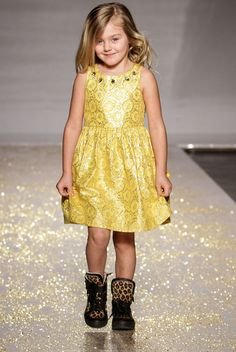 NEW YORK, NY - A model walks the runway at the Vogue Bambini showcase featuring Cupcakes & Pastries during the fall 2013 www.petitePARADE.com Kids Fashion Week at Industria Superstudio on March 10, 2013 in New York City. (Photo by John Parra/Getty Images for petiteParade.) Here, a little shine, a touch of glitz: Cupcakes & Pastries' dress blends sophistication with a touch of whimsy. www.cupcakesandpastries.com