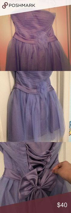 Strapless Purple Formal Dress Size: 4 Purple Poly Deco Mesh Fabric with adjustable, tied backing and a zipper. Strapless. Made in China and worn once for a wedding Dresses Prom