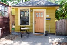 An old garage originally built in 1904 and re-purposed into a backyard tiny home in Portland, Oregon.
