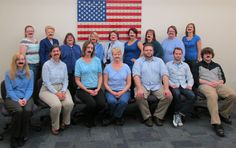 The Library Staff wearing blue and mustaches to support Prostate Cancer Awareness Month and No-Shave November!