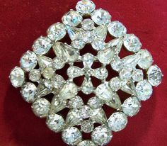 Mid Century Sandor crystal rhinestone square brooch Perfect for wedding bridal jewelry All prong set stones in a silver tone setting No copyright sign, pre 1955 2 1/2 inches square Very good vintage condition, some stones have darkened, setting shows very minor wear International buyers welcome, overcharges are refunded I specialize in vintage rhinestone jewelry, please visit my rhinestone jewelry section Priority shipping is optional 101916  Please visit my other pin selections: https:&...