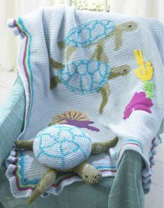 PB009 Turtle Afghan and Pillow Toy Crochet Pattern.  Sea life offers a creative crochet pattern for the Turtle Afghan and Pillow Toy. Kids and animal lovers alike will get a kick out of the side-by-side turtles on this colorful afghan. The coordinating pillow in a turtle shape is the perfect compliment for the sea-inspired afghan.