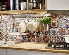 Kitchen accessorie rack with some pots and pans within a natural wood worktop