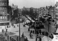 Markt op de Gouds(ch)esingel, je kijkt naar het kruispunt Heerenstraat/Goudschesingel/Jonker Fransstraat, ca. 1936