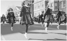 Irish step dancers prance along the parade route during a south Boston St. Patrick's Day Parade in 1997    Read more: Irish Americans - History, Irish emigration, Immigration until the famine years http://www.everyculture.com/multi/Ha-La/Irish-Americans.html#b#ixzz1so7OPnfu