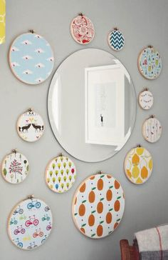 I love this idea - use simple embroidery hoops and quirky fabric or paper to make one-of-a-kind wall decorations.
