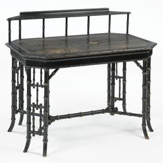 an aesthetic movement ebonized bamboo-turned writing table by howard & sons, circa1880 with a leather-lined writing surface, one drawer stamped HOWARD & SONS BERNERS ST., the locks stamped HOBBS & Co. LEVER LONDON. height 37 3/4 in.; width 44 in.; depth 27 1/4 in.