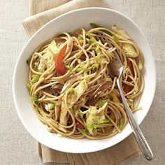 Lime and chile-garlic sauce add some zing to this quick and easy veggie and noodle stir-fry with eggs for added protein.