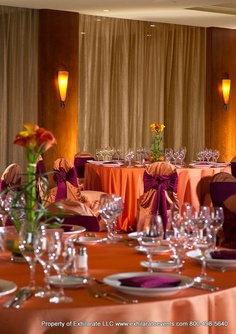 Burgundy and Light Orange Linens with Calla Lilly Centerpiece